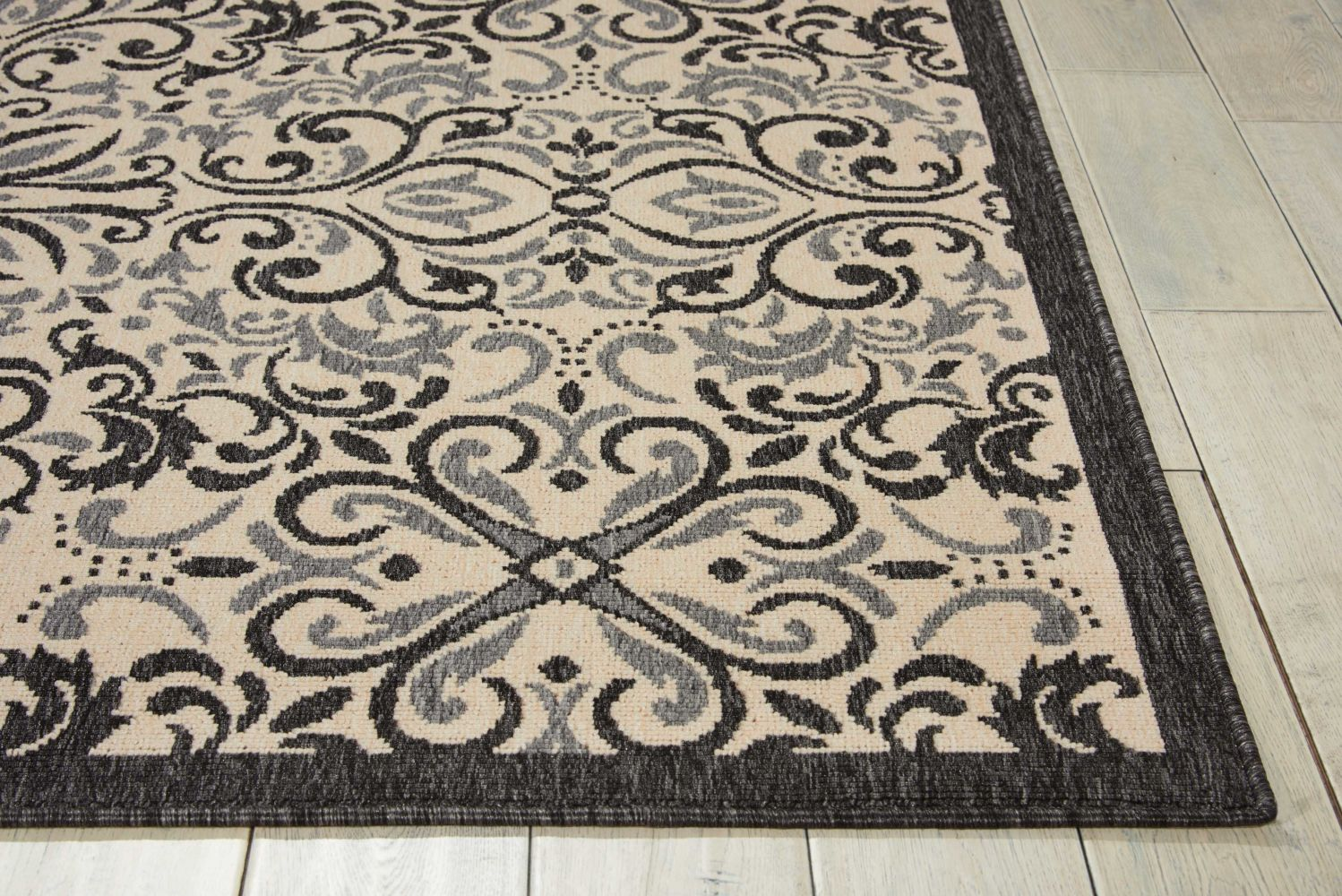 Nourison Caribbean Ivory/Charcoal 2'3″ x 7'6″ Runner CRB12VRYCHRCLRUNNER